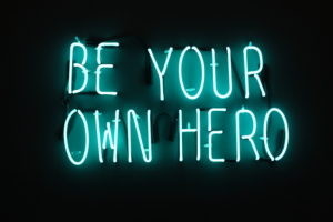 Image of neon sign Outrivals ethos, Be your own hero.
